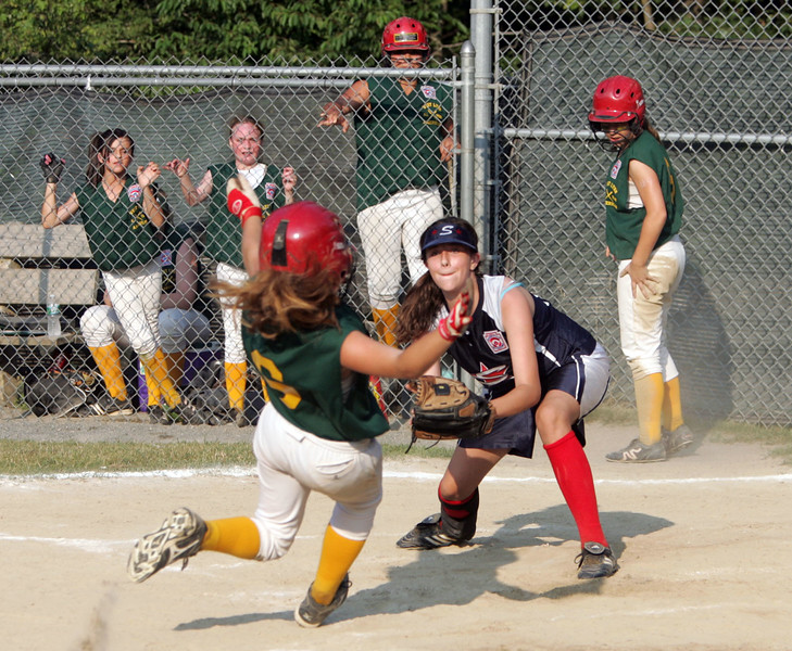 Swampscott's Julia Potter and WLA's Shanon Magner in the Dist. 16 championship game at Lynn Woods field Wednesday July 7, 2010. Item Photo/ Reba M. Saldanha
