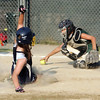 Swampscott's Sophia Kennedy and WLA's COurtney Braswell in the Dist. 16 championship game at Lynn Woods field Wednesday July 7, 2010. Item Photo/ Reba M. Saldanha