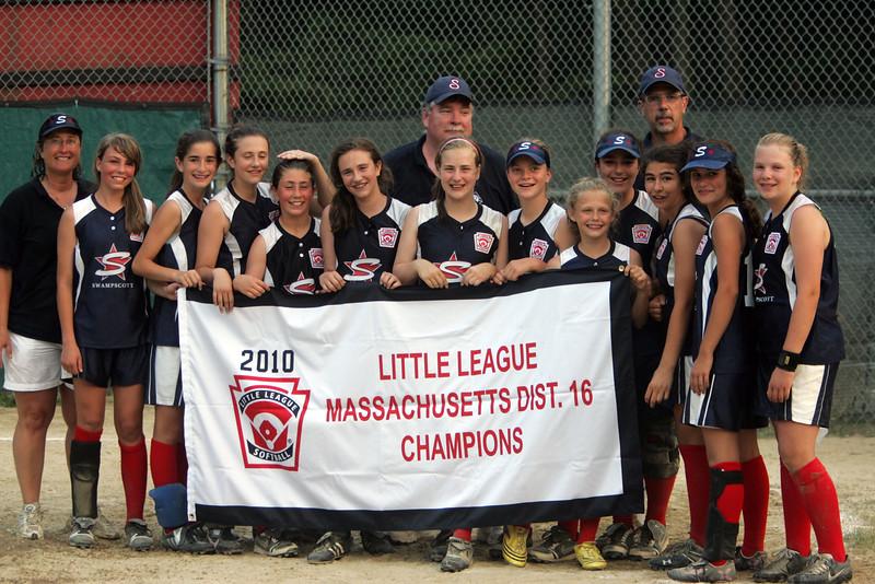 Swampscott holds the banner after winning the  Dist. 16 championship over West Lynn American at Lynn Woods field Wednesday July 7, 2010. Item Photo/ Reba M. Saldanha