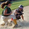 Swampscott's Gabby Fagone  and WLA's Shannon Magner in the Dist. 16 championship game at Lynn Woods field Wednesday July 7, 2010. Item Photo/ Reba M. Saldanha