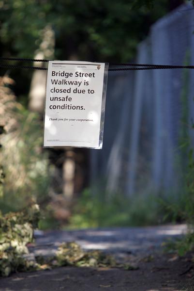 Bridge Street pedestrian walkway that runs behind the Saugus Iron works is closed ude to unsafe conidtions Thursday July 8, 2010. Item Photo/ Reba M. Saldanha