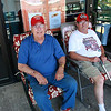 Robert Pacheco, left, and Charlie Vizena beat the heat by relaxing on the porch at GLSS in Lynn.