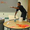 Mario DeArco cleaning the work of vandals in the art room at the Ingalls School today.