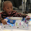 Each student, such as Brandon Billon, at the Lynn Housing Authority and Neighborhood Development Christmas party for Washington School students at the Lynn Housing Authority today got a present from Santa, and once everyone had his or her present in hand, the signal to open them was give.