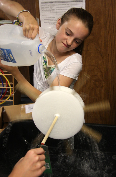 Lauren Moorehouse demonstrates how water creates electricity at the Aborn School science fair. She worked on this project call Hydro Regenerator with her partner Victoria Adams.