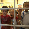 Left to right: Omar Perez Chavez, Jonathan Aquino, and Miguel Pena look out the door of thier classroom at the New Lynn Economic Opportunity child Care Center on Waitt Ave in Lynn.