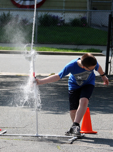 Cameron Powers lets his water bottle rocket fly at the Aborn Science Fair. Alex Rodriguez was his partner.