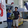 Elaine Caira and Nanhant Lobster and Fish's Tim Pesco pose near their fresh produce stand on Nahant Road  Thursday June 16, 2011. Item Photo/ Cyrus Moulton