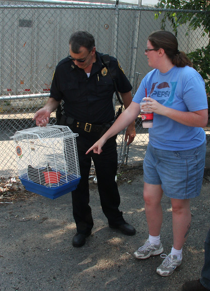 Rachel Donegan was driving by a field on Linden Street when out of the corner of her eye she saw this cage containing a chicken and she called Kevin Farnsworth the animal control officer.