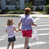 Donna Langlais and her daughter Ashley crossing Walnut Street in front of the Richdale store.