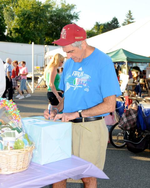 7/28/11, Holy Family Church, Lynn.  Sam Vitale, Lynn, signs up for the raffle.