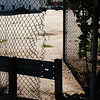 Broken fences are common at Ames Playground in Lynn