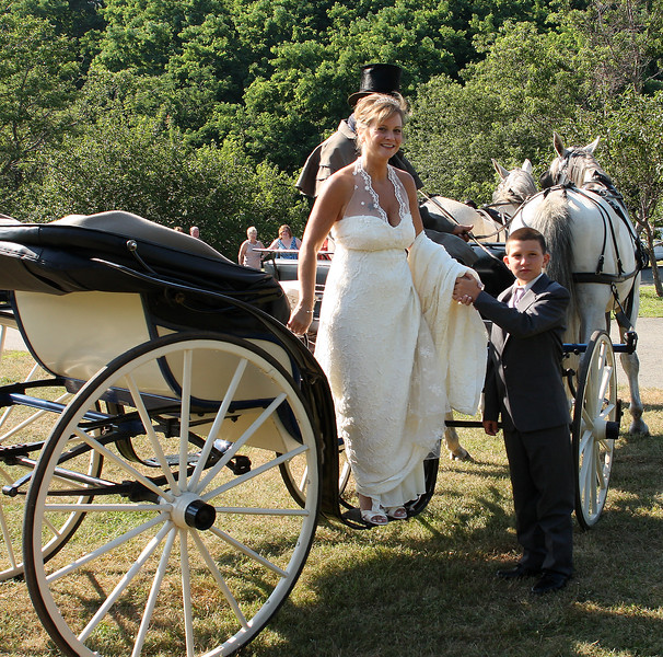 Matthew Luti helps his mom Joanne out of the carriage.