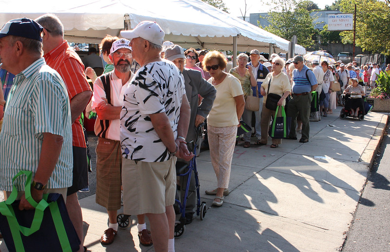 Senior citizens showed up in large numbers at GLSS this morning for free coupons for Farmer's Market.