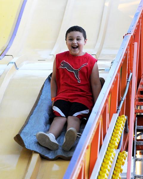 7/28/11, Holy Family Church, Lynn.  The Slide. Jashaun Green, Lynn, on slide.