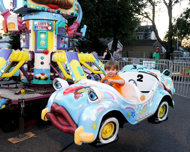 7/28/11, Holy Family Church, Lynn.  Drew Lang, Lynn, aged 2 years, gets his first ride ever on the Taxi Jet.