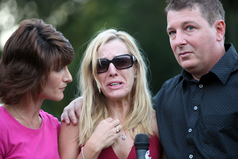 Tricia and Steven Vinci are comforted by famiyl friend Robin Yanonne during a vigil for drowning victim Sydney Vinci, 5,  at Lynnfield Middle school Thursday July 7, 2011. Item Photo/ Reba M. Saldanha