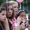 Lynnfield Middle School students (from left) Caroline Waisner, Brianna Weir, Ally Morin, and Jaylin Grabau at a vigil for drowning victim Sydney Vinci at Lynnfield Middle school Thursday July 7, 2011. Item Photo/ Reba M. Saldanha