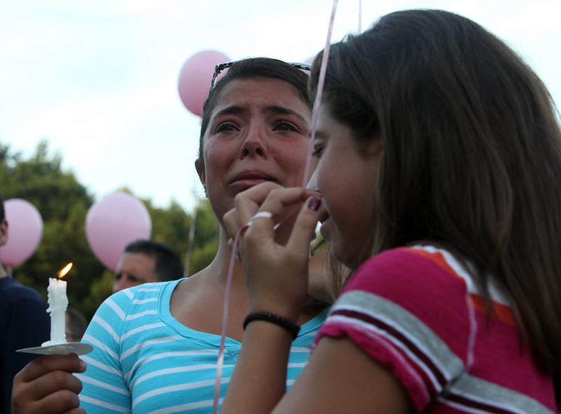 Mourners Christina Montanile, right, and Hailey Castinetti at a vigil for drowning victim Sydney Vinci at Lynnfield Middle school Thursday July 7, 2011. Item Photo/ Reba M. Saldanha