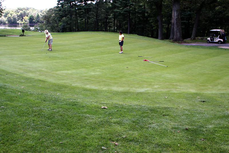 Peg Burke, left, and Linda Bergeron  play on one of the formally damaged greens at Gannon  Golf Course in Lynn.
