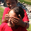 """Sofia Gonzelez, front, and Bianca Figuereo playingthe game called"""" try to figure out who is covering my eyes,"""" at the 5th annual beach day in Nahant hosted by Nancy Whitman with the help of the Nahant Woman's Club."""