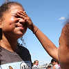 Silyaris Baez, right, puts sun block on Jaleah Perez, left, both from Girl's Inc, today at the 5th annual beach day hosted by Nancy Whitman with the help of the Nahant Women's Club. The girls put on sun block, played some games, had lunch and headed for the beach.