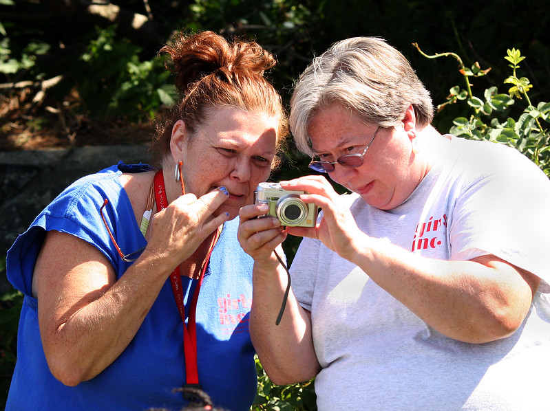 Many pictures were taken and assessed, as evidenced by Sharon Allen, left, and Rachel Tose, at the 5th annual beach day for Girl's Inc. kids hosted by Nancy Whitman in Nahant today.