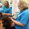 Olivia Devlin cosmetology department braiding hair.