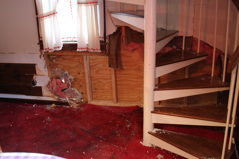 The section of the living room, now boarded up , where a car smashed into the house at 1165 Salem Street in Lynn last night.