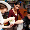 Abby Zarakovich, age 11, shows her bag of homemade ice cream to Laura Pham, age 12, and Steven Barrett, age 11, at the Lynnfield Library's middle school Afternoon Discovery group on Thursday, October 13. By Angela Owens.