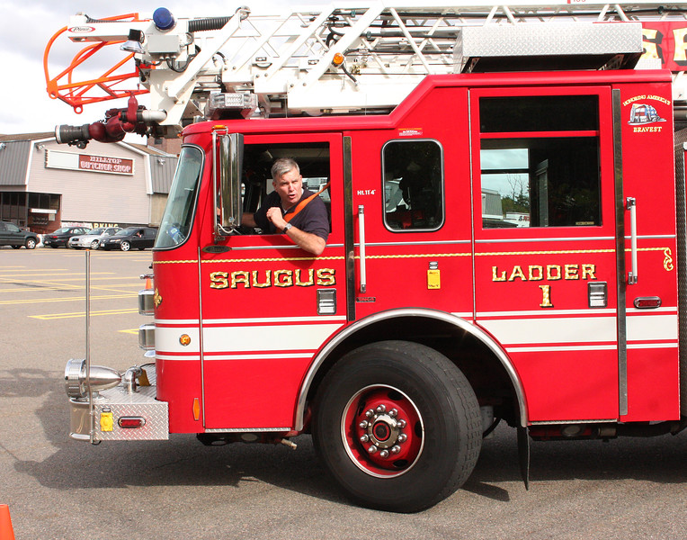 Lt. John O'Brien, Boston Fire, takes Ladder one on the course.