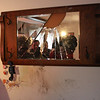 Phil Torto is interviewed by Channel Seven after a car smashed into his house last night. This mirror, located on the wall opposite where the crash hapened, was damaged.