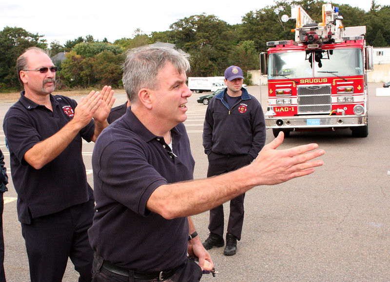 Lt. Jim O'Bien, Boston Fire, middle, showing Engine Lt. Tom Kaminski, left, and Mike Barker where to drive their truck during fire truck training in Saugus today.