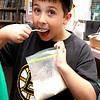 Steven Barrett, age 11, tries a spoonful of his homemade ice cream, which he made at the Lynnfield Library's middle school Afternoon Discovery group on Thursday, October 13. By Angela Owens.