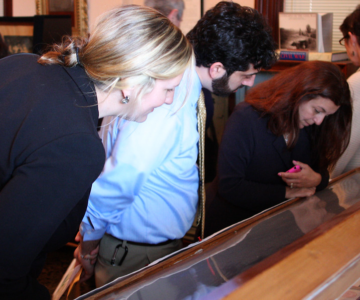 From left to right: Christine Proffitt, Cultural site advisor, Jesse Kanson-Benanav, consultant and Mayor Kennedy look at exhibit at the GAR.