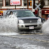 A car drives through the flooded Peabody Square on Tuesday, October 4. By Angela Owens.