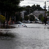 A car is abandoned on Foster Street, after Peabody Square flooded on Tuesday, October 4. By Angela Owens.