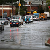 Traffic skirts the edge of the flooded Peabody Square on Tuesday, October 4. By Angela Owens.