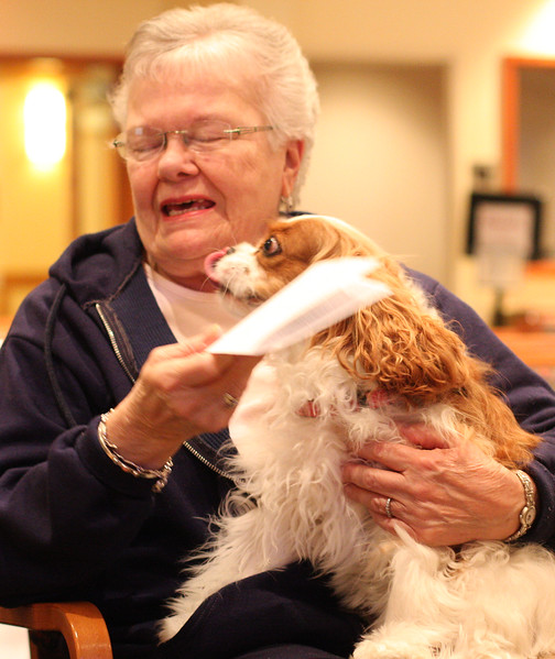 Joanne Comb gets a kiss from her dog Winter during the blessing of the Pets ceremony at Brooksby Village today.;