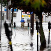 A man wades through the water on Foster Street, after Peabody Square flooded on Tuesday, October 4. By Angela Owens.