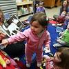 Hannah Kansiewicz, 1, participates in story time with new library director Theresa Hurley Monday Jan 31, 2011. Item Photo/ Reba M. Saldanha