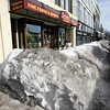Only a small break in the snow filled sidewalk in front of Tatiana's Restaurant in Lynn allows for access to the downtown eatery. Item Photo/ Reba M. Saldanha