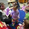 Kamille Santana, 1, participates in story time with new library director Theresa Hurley Monday Jan 31, 2011. Item Photo/ Reba M. Saldanha