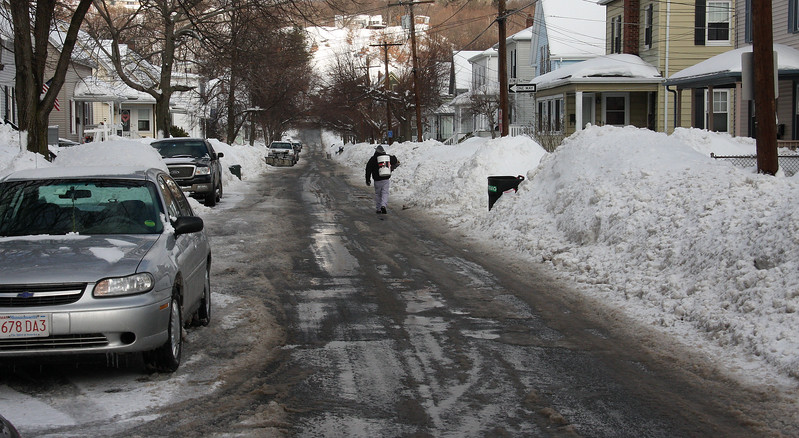 cars are parked correctly on Wyman Street in Lynn. bill Townsend Jr. is walking down the street.