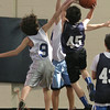 Anthony Tzortzis, 9, blocks Christan Tehan, 45.
