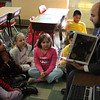 Charlie Gallo,  Lynn School Committee Elect, reads the Polar Express to a third grade class at the Sisson Elementary School in Lynn today. Photo by Owen O'Rourke
