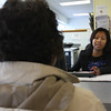 Lynna Chear, a bilingual advocate, helps a client with the fuel assistance program application process at the Lynn Economic Oportunity office on Broad Street in Lynn today. Photo by Oen O'Rourke