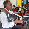Essex County Sheriff Frank Cousins reads the Polar Express to a fourth grade class at the Sisson Elementary School in Lynn today.