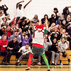 A fan in holdiay gear gets the crowd riled up during the game against Salem at Classical on Thursday, December 22. Item Photo / Angela Owens.