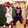 Salem's Nick Walsh (32) guards Classical's Moise Builou (11) during their game on Thursday, December 22. Item Photo / Angela Owens.